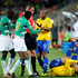 Luis Fabiano Photos - Michel Bastos of Brazil speaks to referee Stephane Lannoy  as Luis Fabiano lies on the ground injured during the 2010 FIFA World Cup South Africa Group G match between Brazil and Ivory Coast at Soccer City Stadium on June 20, 2010 in Johannesburg, South Africa. - Brazil v Ivory Coast: Group G - 2010 FIFA World Cup