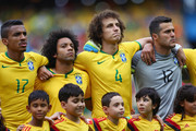 (L-R) Luiz Gustavo of Brazil, Marcelo, David Luiz and Julio Cesar look on before the 2014 FIFA World Cup Brazil Group A match between Brazil and Mexico at Castelao on June 17, 2014 in Fortaleza, Brazil.