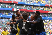 Roberto Firmino of Brazil celebrates with teammates after scoring his team's second goal during the 2018 FIFA World Cup Russia Round of 16 match between Brazil and Mexico at Samara Arena on July 2, 2018 in Samara, Russia.