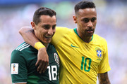 Neymar Jr of Brazil hugs Andres Guardado of Mexico during the 2018 FIFA World Cup Russia Round of 16 match between Brazil and Mexico at Samara Arena on July 2, 2018 in Samara, Russia.
