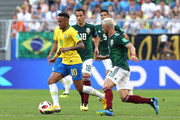 Neymar Jr of Brazil is challenged by Carlos Salcedo of Mexico during the 2018 FIFA World Cup Russia Round of 16 match between Brazil and Mexico at Samara Arena on July 2, 2018 in Samara, Russia.