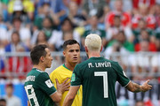 Philippe Coutinho of Brazil confronts Miguel Layun of Mexico during the 2018 FIFA World Cup Russia Round of 16 match between Brazil and Mexico at Samara Arena on July 2, 2018 in Samara, Russia.