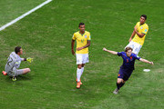 Daley Blind of the Netherlands celebrates scoring his team's second goal as goalkeeper Julio Cesar (L), Luiz Gustavo (C) and Paulinho of Brazil react during the 2014 FIFA World Cup Brazil Third Place Playoff match between Brazil and the Netherlands at Estadio Nacional on July 12, 2014 in Brasilia, Brazil.
