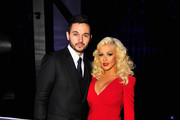 Singer Christina Aguilera (R) and Matt Rutler attend the Breakthrough Prize Awards Ceremony Hosted By Seth MacFarlane at NASA Ames Research Center on November 9, 2014 in Mountain View, California.