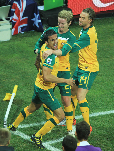 Australia v Serbia: Group D - 2010 FIFA World Cup [player,sports,team sport,ball game,soccer player,football player,tournament,sports equipment,soccer,team,team mates,tim cahill,david carney,brett holman,r,c,goal,australia,serbia: group d,2010 fifa world cup]
