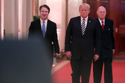 (L-R) U.S. Supreme Court Justice Brett Kavanaugh, President Donald Trump and retired Justice Anthony Kennedy walk into the East Room of the White House for Kavanaugh's ceremonial swearing in October 08, 2018 in Washington, DC. Kavanaugh was confirmed in the Senate 50-48 after a contentious process that included several women accusing Kavanaugh of sexual assault. Kavanaugh has denied the allegations.
