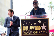 Brett Ratner and Eddie Murphy attend Ratner's star on the Walk of Fame in Hollywood on January 19, 2017. / AFP / CHRIS DELMAS