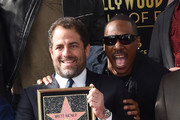 Film director Brett Ratner and actor Eddie Murphy attend Ratner's star on the Walk of Fame ceremony in Hollywood on January 19, 2017. / AFP / CHRIS DELMAS