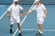 James Blake and Andy Roddick of the USA celebrate after winning a point during their first round doubles match against Travis Parrott of the USA and Jaroslav Levinsky of the Czech Republic during day one of the Brisbane International 2010 at the Queensland Tennis Centre on January 3, 2010 in Brisbane, Australia.