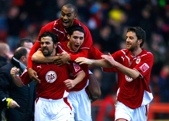 Paul Hartley (L) of Bristol City celebrates with his team mates after scoring his side's second goal during the Coca Cola Championship match between Bristol City and Watford at Ashton Gate on December 28, 2009 in Bristol, England.