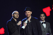 Jonny Buckland and Will Champion of Coldplay receive the award for British Live Act on stage during the Brit Awards 2013 at the 02 Arena on February 20, 2013 in London, England.