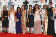 Perrie Edwards, Jade Thirlwall, Jesy Nelson and Leigh-Anne Pinnock from Little Mix with their mothers attend the BRIT Awards 2016 at The O2 Arena on February 24, 2016 in London, England.