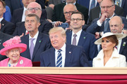 Queen Elizabeth II, US President, Donald Trump and US First Lady Melania Trump attend the D-day 75 Commemorations on June 05, 2019 in Portsmouth, England. The political heads of 16 countries involved in World War II joined Her Majesty, The Queen is on the UK south coast for a service to commemorate the 75th anniversary of D-Day. Overnight it was announced that all 16 had signed an historic proclamation of peace to ensure the horrors of the Second World War are never repeated. The text has been agreed by Australia, Belgium, Canada, Czech Republic, Denmark, France, Germany, Greece, Luxembourg, Netherlands, Norway, New Zealand, Poland, Slovakia, the United Kingdom and the United States of America. (Photo by Chris Jackson-WPA Pool/Getty Images