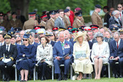Secretary of State for Defence, Penny Mourdaunt, Prince Charles, Prince of Wales, Camilla, Duchess of Cornwall and Britain's Prime Minister Theresa May attend a memorial service at Bayeux War Cemetery on June 06, 2019 in Bayeux, France. Veterans, families, visitors, political leaders and military personnel are gathering in Normandy to commemorate D-Day, which heralded the Allied advance towards Germany and victory about 11 months later.