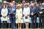 Prince Charles, Prince of Wales, Camilla, Duchess of Cornwall and Britain's Prime Minister Theresa May attend a memorial service at Bayeux War Cemetery on June 06, 2019 in Bayeux, France. Veterans, families, visitors, political leaders and military personnel are gathering in Normandy to commemorate D-Day, which heralded the Allied advance towards Germany and victory about 11 months later.
