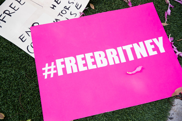 #FreeBritney Protest - West Hollywood, CA [text,pink,font,text,magenta,material property,grass,paper product,textile,paper,plant,britney spears,freebritney protest - west hollywood,signs,font,support,product,ca,offices,protest,design,banner,graphics,meter,product,font,eikon]