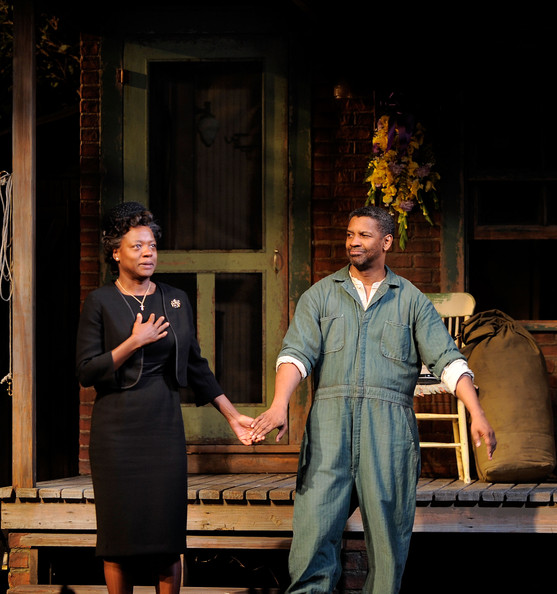 "Actress Viola Davis and actor Denzel Washington take a bow during the curtain call for the Broadway Opening of ""Fences"" at the Cort Theatre on April 26, 2010 in New York City."