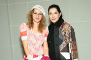 """(L-R) Artist Olek and performance artist/honoree Marina Abramovic attend Brooklyn Museum's """"Women In the Arts"""" Luncheon on November 5, 2015 in Brooklyn, New York."""