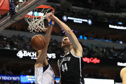 Tyler Zeller #44 of the Brooklyn Nets makes the slam dunk against Salah Mejri #50 of the Dallas Mavericks in the first half at American Airlines Center on November 29, 2017 in Dallas, Texas.  NOTE TO USER: User expressly acknowledges and agrees that, by downloading and or using this photograph, User is consenting to the terms and conditions of the Getty Images License Agreement.