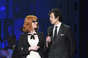 Christina Hendricks (L) and Geoffrey Arend speak onstage during the Brooks Brothers Bicentennial Celebration at Jazz At Lincoln Center on April 25, 2018 in New York City.