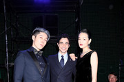 (L-R) MIYAVI, Zac Posen and Ai Tominaga pose for a photo during the Brooks Brothers special runway show celebrating its 40th anniversary in Japan on May 23, 2019 in Tokyo, Japan.