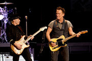 Musicians Nils Lofgren (L) and Bruce Springsteen and the E Street Band perform at the Los Angeles Sports Arena on March 15, 2016 in Los Angeles, California.