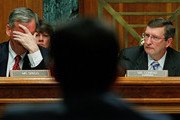 Senate Budget Committee ranking member Sen. Judd Gregg (R-NH) (L) and Chairman Kent Conrad (D-ND) listen to testimony from White House Office of Managment and Budget Director Peter Orszag about the Obama Administration's FY2011 budget on Capitol Hill February 2, 2010 in Washington, DC. Gregg accused Orszag and the administration of not following the law when it proposes using TARP funds as loans to small businesses instead of using the money to pay down the deficit.