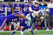 Tavon Austin #10 of the Dallas Cowboys is tackled by Levi Wallace #39 and Lorenzo Alexander #57 of the Buffalo Bills in the fourth quarter at AT&T Stadium on November 28, 2019 in Arlington, Texas.