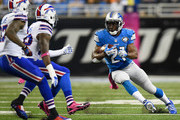Reggie Bush #21 of the Detroit Lions looks for an opening up field in the third quarter while playing the Buffalo Bills at Ford Field on October 05, 2014 in Detroit, Michigan.
