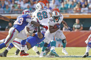 Reggie Bush #22 of the Miami Dolphins runs with the ball against the Buffalo Bills on December 23, 2012 at Sun Life Stadium in Miami Gardens, Florida. The Dolphins defeated the Bills 24-10.