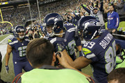 Tight end Jimmy Graham #88 of the Seattle Seahawks is mobbed by teammates after scoring a touchdown against the Buffalo Bills at CenturyLink Field on November 7, 2016 in Seattle, Washington.