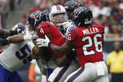 Deshaun Watson #4 of the Houston Texans is sacked by Kyle Williams #95 of the Buffalo Bills in the first half at NRG Stadium on October 14, 2018 in Houston, Texas.