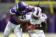 Chris Ivory #33 of the Buffalo Bills is tackled with the ball by Xavier Rhodes #29 of the Minnesota Vikings in the first quarter of the game at U.S. Bank Stadium on September 23, 2018 in Minneapolis, Minnesota.