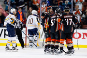 Ryan Getzlaf #15, Hampus Lindholm #47, and David Perron #57 of the Anaheim Ducks react to a goal during the second period of a game against the Buffalo Sabres  at Honda Center on February 24, 2016 in Anaheim, California.