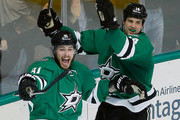 Tyler Seguin #91 of the Dallas Stars and Jamie Benn #14 of the Dallas Stars celebrate after the Stars score against the Buffalo Sabres in the third period at American Airlines Center on March 23, 2015 in Dallas, Texas.