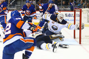 Robin Lehner #40 of the Buffalo Sabres is unable to keep the puck from crossing the goal line on a game-tying goal by Josh Bailey #12 of the New York Islanders during the third period at Barclays Center on December 27, 2017 in New York City.