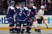 The New York Islanders celebrate a powerplay goal by Kyle Okposo #21 at 6:37 of the first period against the Buffalo Sabres at the Nassau Veterans Memorial Coliseum on April 4, 2015 in Uniondale, New York.