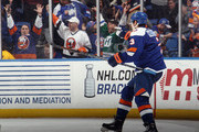 Travis Hamonic #3 of the New York Islanders celebrates a goal by Nikolay Kulemin #86 at 13:13 of the third period against the Buffalo Sabres at the Nassau Veterans Memorial Coliseum on April 4, 2015 in Uniondale, New York. The Islanders shut out the Sabres 3-0. Kulemin was playing in his 500th NHL game.