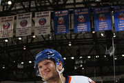 Kyle Okposo #21 of the New York Islanders leaves the ice after being named the second star of the game against the Buffalo Sabres at the Nassau Veterans Memorial Coliseum on April 4, 2015 in Uniondale, New York. The Islanders shut out the Sabres 3-0.