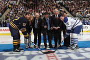 (L-R) Cammi Granato, Jim Devellano, Dino Ciccarelli, Bob Seaman, and Angela James drop the puck between Craig Rivet #52 of the Buffalo Sabres and Tomas Kaberle #15 of the Toronto Maple Leafsat the Air Canada Centre on November 6, 2010 in Toronto, Canada.