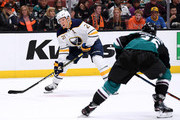 Kyle Okposo #21 of the Buffalo Sabres prepares to shoot in front of Brandon Montour #26 of the Anaheim Ducks  at Honda Center on October 21, 2018 in Anaheim, California.