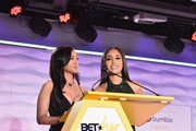 Cymphonique Miller (L) and Saweetie speak onstage at the BETHer Awards, presented by Bumble, at The Conga Room at L.A. Live on June 21, 2018 in Los Angeles, California.