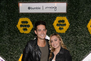 Brandi Cyrus (R) hosts the BumbleSpot #atthemoxy launch with special guest Wells Adams (L) at moxy Chicago Downtown on November 15, 2018 Chicago, Illinois.