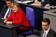 German Chancellor Angela Merkel (2nd L) and German Vice Chancellor and Foreign Minister Sigmar Gabriel (L) listen as Marco Buschmann (R) of the free democratic FDP party gives a speech during a session at the Bundestag (lower house of parliament) on November 21, 2017 in Berlin. / AFP PHOTO / Odd ANDERSEN