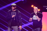 Special guest Xavier Naidoo (L) and Kool Savas (R) perform during the Bundesvision Song Contest 2013 at SAP Arena on September 26, 2013 in Mannheim, Germany.