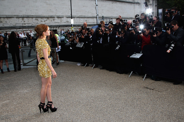 Emma Watson Emma Watson dressed in Burberry arrives at the Burberry Prorsum