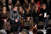(L-R) Maggie Gyllenhaal, Sam Smith, Cara Delevingne, Jourdan Dunn, Kate Moss and Mario Testino attend the Burberry Prorsum AW 2015 show during London Fashion Week at Kensington Gardens on February 23, 2015 in London, England.