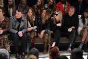 (L-R) Maggie Gyllenhaal, Sam Smith, Cara Delevingne, Jourdan Dunn, Kate Moss, Mario Testino and Naomi Campbell attend the Burberry Prorsum AW 2015 show during London Fashion Week at Kensington Gardens on February 23, 2015 in London, England.