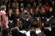 (L-R) Clemence Posey, Maggie Gyllenhaal, Sam Smith, Cara Delevingne, Jourdan Dunn, Kate Moss and Mario Testino attend the Burberry Prorsum AW 2015 show during London Fashion Week at Kensington Gardens on February 23, 2015 in London, England.