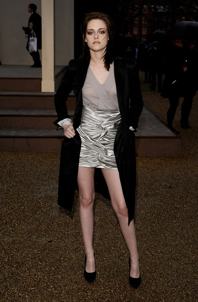 Actress Kristen Stewart wearing Burberry attends the Burberry Prorsum LFW Autumn/Winter 2010 Women?s wear show at the Parade Ground, Chelsea College of Art on February 23, 2010 in London, England.